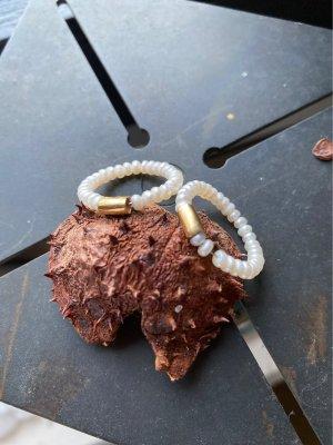 Bague incrustée de pierres doré-blanc