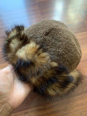 Chapeau en fourrure bronze-noir