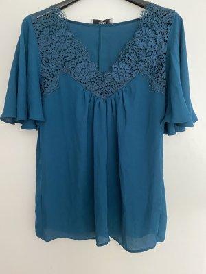 Petrolfarbene elegante Bluse mit Spitzeneinsatz von Mango Suit