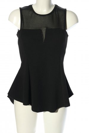 PIAZA ITALIA Top peplum negro estilo «business»