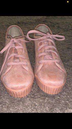 Zapatillas con tacón rosa claro