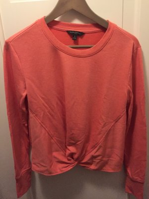 Pinker Cropped Pullover mit Knotendetail