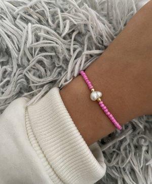 Bracelet en perles rose