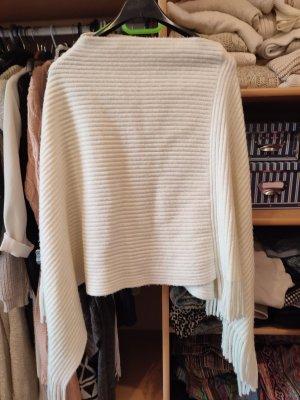 Poncho en tricot blanc cassé-crème