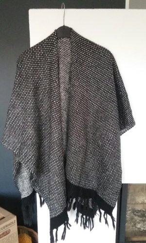 Gaudi Poncho en tricot blanc-noir laine