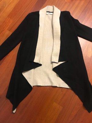 Zara Poncho en tricot noir-crème