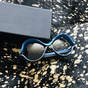 Occhiale da sole rotondo blu fiordaliso-argento