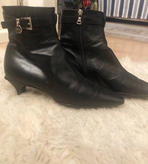 Prada/ Boots