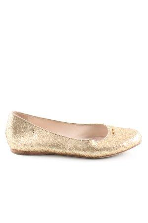 Prada Bailarinas plegables color oro look casual
