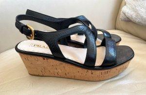 Prada Sandalias con plataforma negro-color oro Cuero