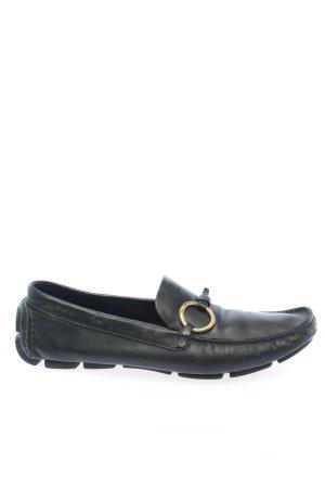 Prada Zapatos sin cordones negro-color oro look casual