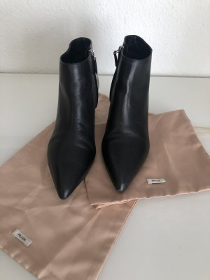 Prada Bottines à fermeture éclair noir cuir