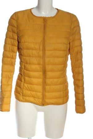 Promod Chaqueta acolchada amarillo pálido estampado acolchado look casual