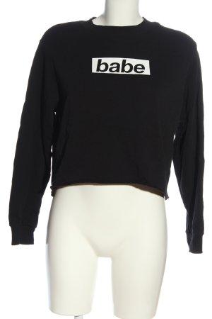 Pull & Bear Suéter negro-blanco letras impresas look casual
