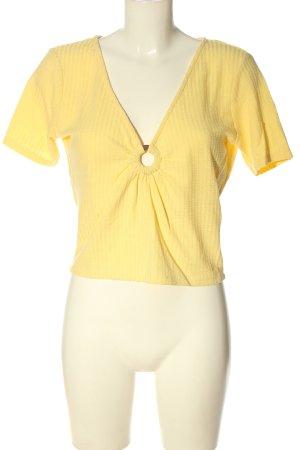 Pull & Bear V-Ausschnitt-Shirt blassgelb Allover-Druck Casual-Look