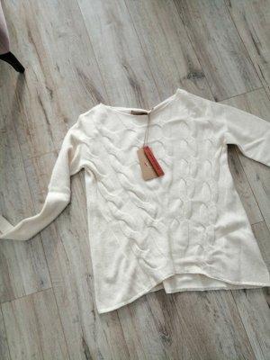Jersey trenzado crema
