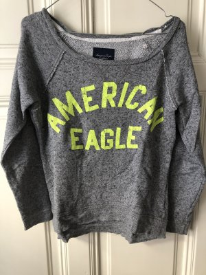 Pullover grau mit Neon-Schrift