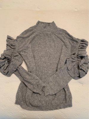 Pullover mit acht-Outs und Rüschen