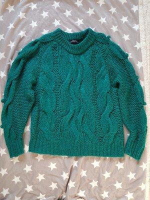Pullover mit Bömmelchen