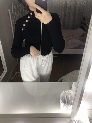 Pullover mit details