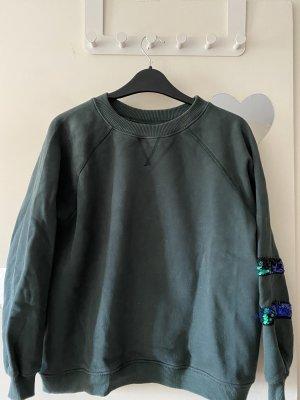 Pullover mit Glitzer am linken Ärmel