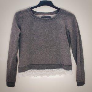 Pullover mit Spitze am Saum