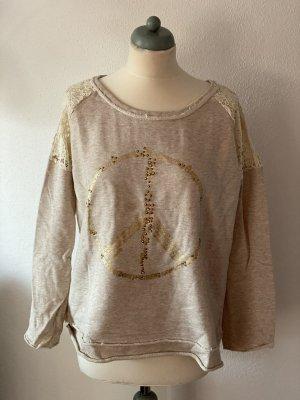 Pullover mit Stickerein und Spitze