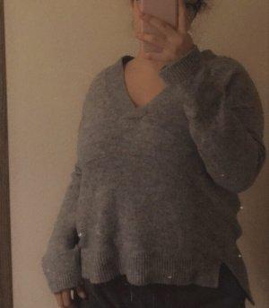 Pullover mit V-Schnitt