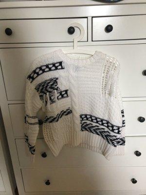 Pullover mit verschiedenen Mustern