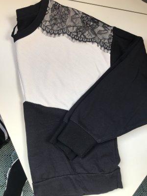 Pullover oversized mit spitze und überschnittenen ärmeln
