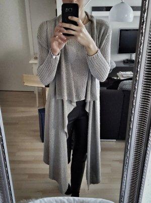 Pullover und Weste