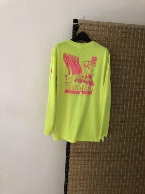 Puma Langarmshirt in neongelb mit grafischem Print