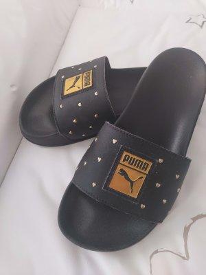 Puma Strandsandalen zwart-goud