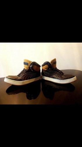 Alexander McQueen / Puma High top sneaker zwart-goud