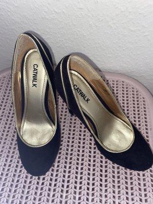 Catwalk Plateauzool pumps zwart-goud