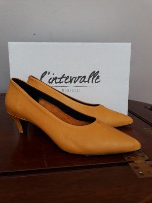 Stiletto jaune foncé cuir