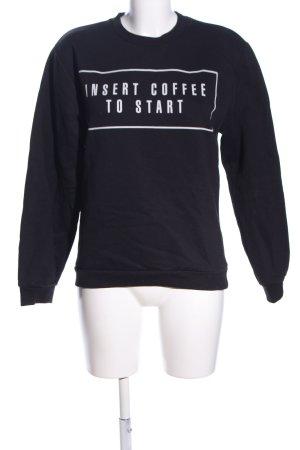 Rad. Suéter negro-blanco letras impresas look casual