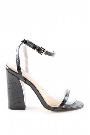 Strapped pumps black animal pattern casual look