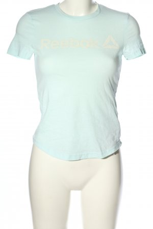 Reebok Camisa deportiva turquesa letras impresas look casual