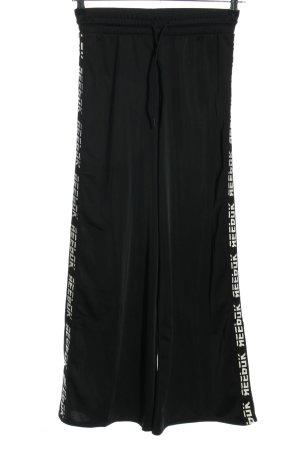 Reebok Pantalon de jogging noir-blanc lettrage imprimé style athlétique