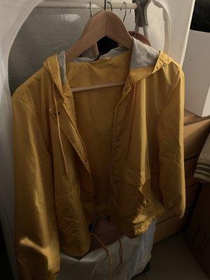 H&M Divided Regenjas geel