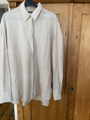 Reserved Blusa brillante crema
