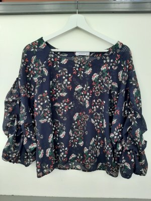 Reserved Blumenbluse