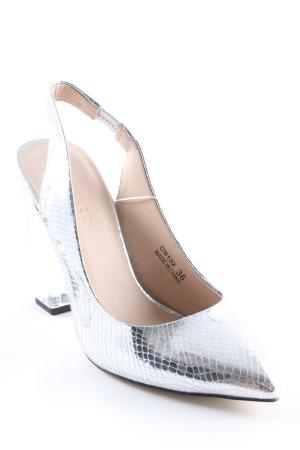 Reserved High Heels silberfarben-schwarz Animalmuster extravaganter Stil