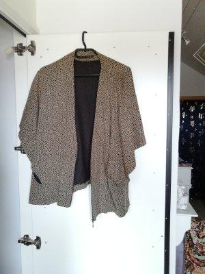 Poncho en tricot noir-marron clair