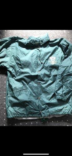 Manteau de pluie kaki-vert forêt