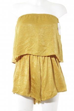 Reverse Jumpsuit gold-colored casual look