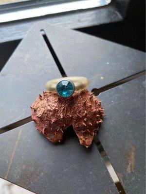 Bague incrustée de pierres turquoise-bleu cadet