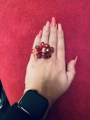 Bague incrustée de pierres rose-rouge framboise