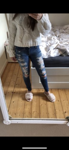 Ripped midrise Stretch Jeans